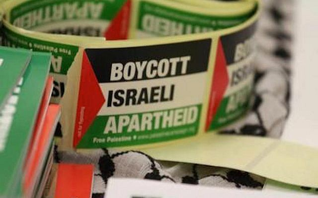 Stickers calling for a boycott of Israel