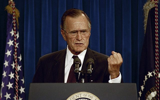 President George H.W. Bush gestures during a news conference at the White House in Washington, DC, September 12, 1991. (AP/ Greg Gibson)