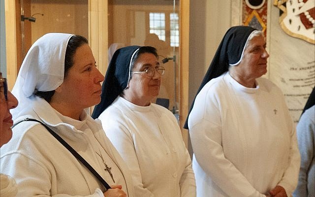 Nuns listen to a Christmas speech by Daniel de Petri Testaferrata, president of the SMOM's Maltese Association, thanking them for their works of charity throughout the year. (Larry Luxner)