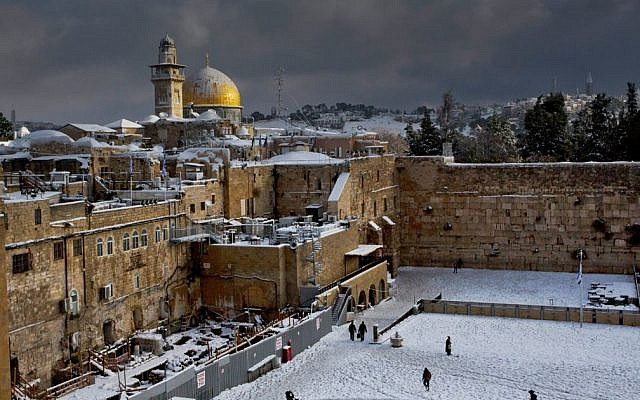 The Western Wall and the Dome of the Rock in Jerusalem, among the holiest sites respectively for Jews and Muslims, are covered in snow, December 13, 2013. (AP/Dusan Vranic, File)
