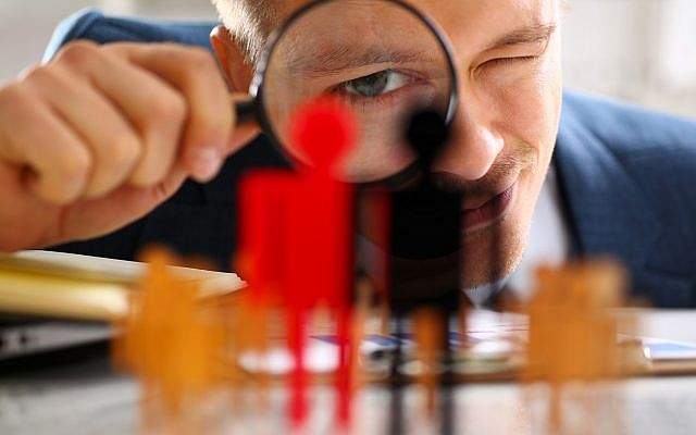 Illustrative. Investigating, under a magnifying glass. (iStock)