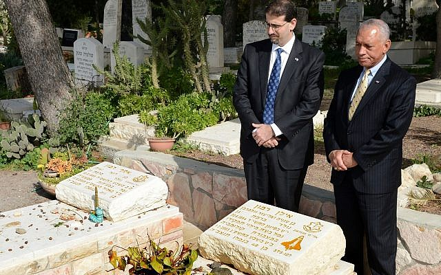 NASA Administrator Charles Bolden, right, and US Ambassador Dan Shapiro visit the graves of Ilan and Asaf Ramon in Nahalal Cemetery, January 28, 2012. (Matty Stern/US Embassy/ Flash90)