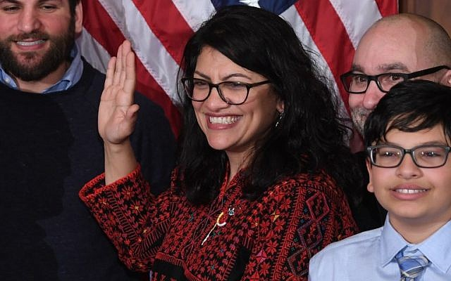 (FILES) In this file photo taken on January 3, 2019, US House Representative Rashida Tlaib participates in a ceremonial swearing-in at the start of the 116th Congress at the US Capitol in Washington, DC. - Tlaib kicked off her term with an expletive-laced vow to impeach President Donald Trump, triggering Republican outrage and testing party discipline barely a day after Democrats regained the House. (Photo by SAUL LOEB / AFP)