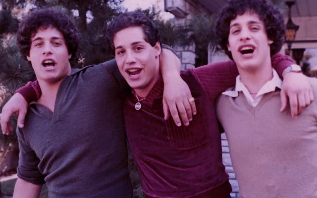 'Three Identical Strangers' is a documentary about triplets separated at birth by a Jewish-affiliated adoption agency in 1961. (Courtesy of NEON)