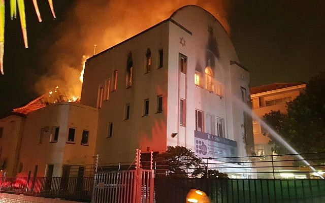 Fire fighters try to quell flames at Beit Midrash Morasha in Cape Town (Lance Katz)