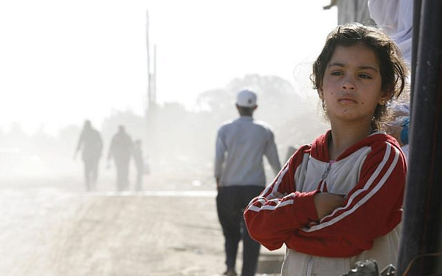 An Arab girl stands outside her house at the Dahamshe neighborhood between Ramla and Lod, December 31, 2007. (Michal Fattal/Flash90)