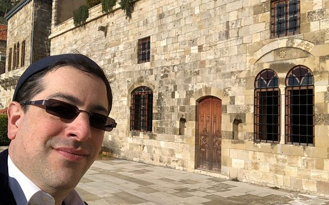 Alex outside 17th century synagogue in Deir am Qamar