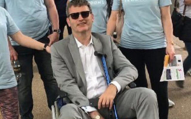 Mark Lewis during this the 2018 Al-Quds Day parade, which he temporarily halted in his wheelchair (Jewish News)