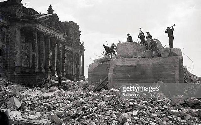(Original Caption) 7/11/51-Berlin, Germany: The arduous task of removing one of the bunkers in front of the Reichstag. It was used by German troops in their last-ditch battle in Berlin. Acme photo by staff photographer Allyn Z. Baum