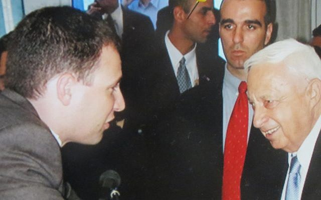 The columnist (left) with General (and PM) Ariel Sharon in 2002.