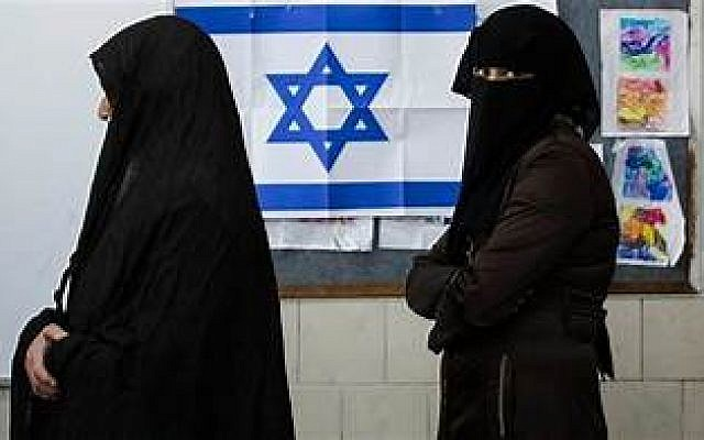 Waiting their turn at an Israeli polling station.