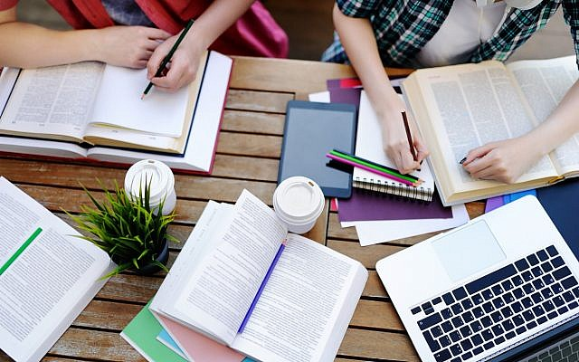 Illustrative. Students studying, conducting, literary analysis, or the like. (iStock)