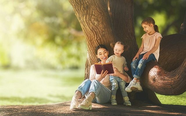 Illustrative. Mother reading to children. (iStock)