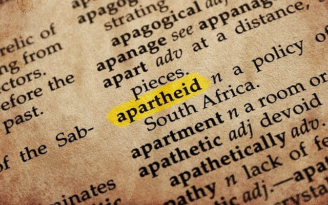 Apartheid word in old textured dictionary (Shutterstock).