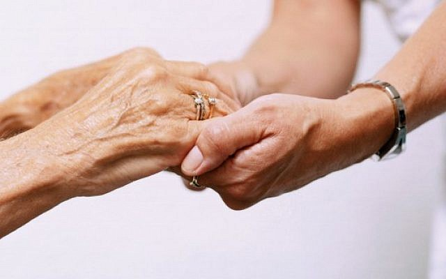 Elderly and young people lock hands  (Jewish News)