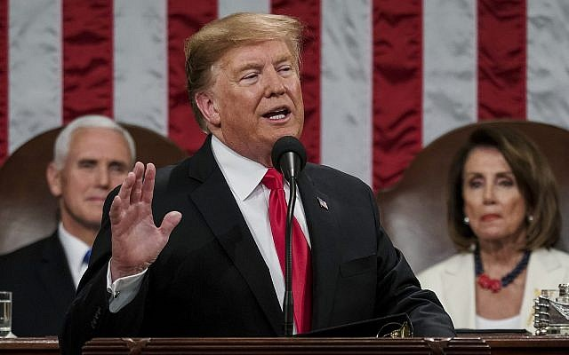US President Donald Trump gives his State of the Union address to a joint session of Congress, February 5, 2019, at the Capitol in Washington, DC, as Vice President Mike Pence, left, and House Speaker Nancy Pelosi look on. (Doug Mills/The New York Times via AP, Pool)