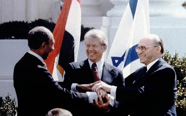 Anwar Sadat, Jimmy Carter and Menahem Begin sign Israel-Egypt Peace Treaty on the White House Lawn, March 26, 1979