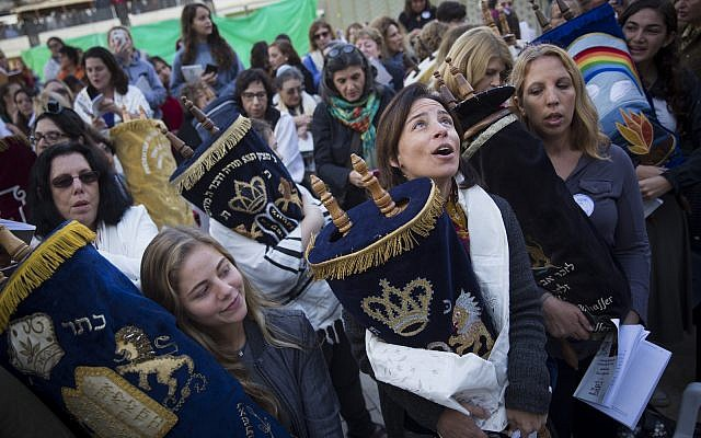 Women of the Wall, together with a group of American Conservative and Reform rabbis, hold Torah scrolls during a protest march against the government's failure to deliver a new prayer space at the Western Wall,, November 2, 2016. (Hadas Parush/Flash90)