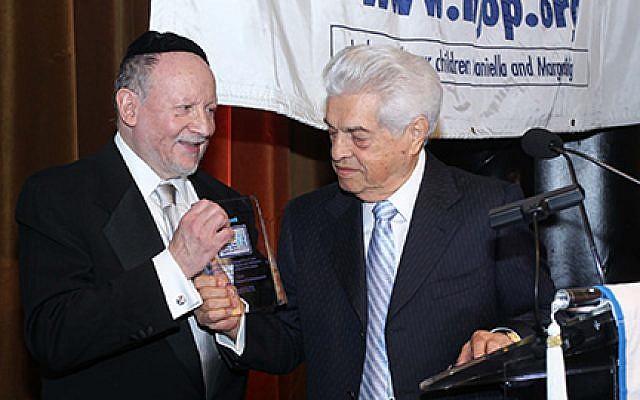 Sam Domb (right) and Rabbi Ephraim Buchwald