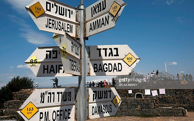 A sign for tourists shows the direction to Jerusalem, Amman, Damascus and Baghdad among other destinations at an army post on Mount Bental in the Israeli-annexed Golan Heights on March 22, 2019. - The Syrian government condemned US President Donald Trump's pledge to recognise Israel's annexation of the Golan Heights, saying it flies in the face of international law. (Photo by JALAA MAREY / AFP)        (Photo credit should read JALAA MAREY/AFP/Getty Images)