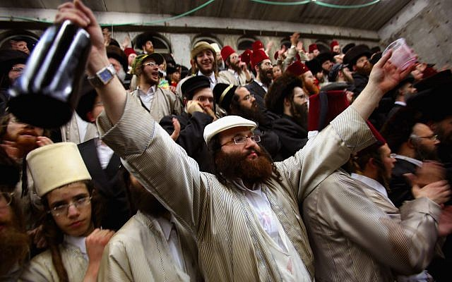 Haredi Jews revel in Purim at a synagogue in Beit Shemesh, Israel, March 2019. (David Silverman/ Getty Images via JTA)