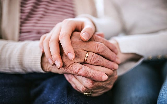 Illustrative. From generation to generation: a granddaughter holds her grandmother's hands. (iStock)