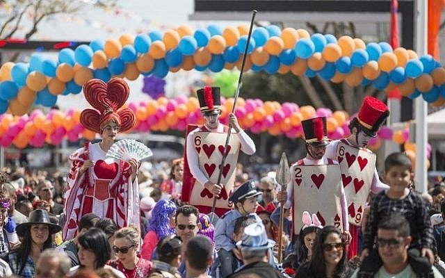 Illustrative. Dressed-up Israelis take part in a parade during the festivities of the Jewish Purim festival on March 5, 2015, in the central Israeli city of Netanya. (photo credit: AFP PHOTO/Jack Guez/File)