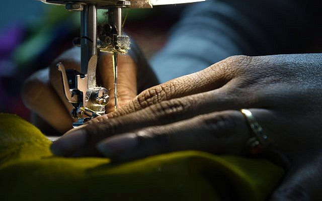 Illustrative. Sewing at a sewing machine. (iStock)