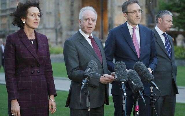 Members of the Board of Deputies (left to right) Gillian Merron, former president  Jonathan Arkush, alongside Jonathan Goldstein, and Simon Johnson, formerly of the JLC, speak to the media on College Green following a meeting with Labour leader Jeremy Corbyn in 2018.  (Photo credit: Jonathan Brady/PA Wire via Jewish News)
