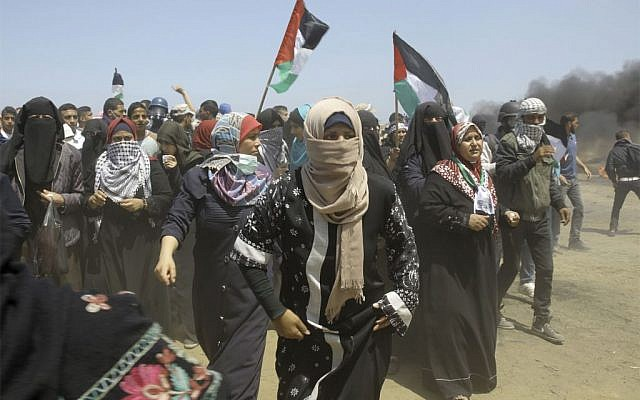 Palestinian women chant slogans as protesters burn tires near the Gaza Strip's border with Israel, east of Khan Younis, in the Gaza Strip, Monday, May 14, 2018.   (AP Photo/Adel Hana - via Jewish News)
