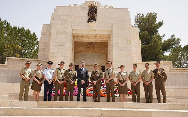H.E. Mr Christopher Cannan, Australian Ambassador to Israel, surrounded by Australian military and the Australian Contingent to the Multinational Force