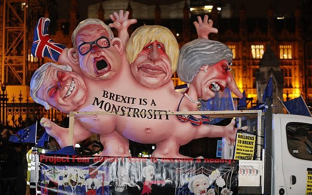 An anti-Brexit effigy is driven around Parliament square after the results of the vote on British Prime Minister Theresa May's Brexit deal were announced in London, Tuesday, Jan. 15, 2019. AP Photo/Frank Augstein)