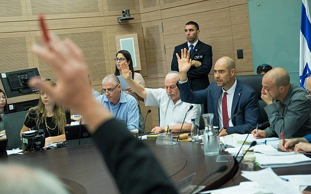 Illustrative: Committee Chairman Amir Ohana and Jewish Home parliament members Nissam Slomiansky vote at the joint Knesset and Constitution Committee meeting discussing the proposed National Law, at the Knesset, on July 17, 2018. (Yonatan Sindel/Flash90)