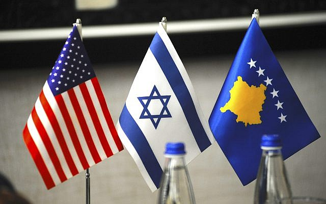Flags of the United States, Israel and Kosovo on display in the Prishtinë office of Prime Minister Ramush Haradinaj. (Larry Luxner)