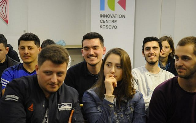 Young people listen to a lecture by visiting American Jewish public relations executive Ari Zoldan at the Innovation Center Kosovo (ICK) in Prishtinë. (Larry Luxner)