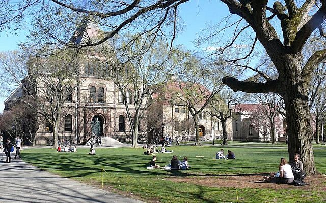 Illustrative. Students sitting in the College Green outside Sayles Hall on the Brown University campus in Providence, Rhode Island. (Wikimedia Commons via JTA)