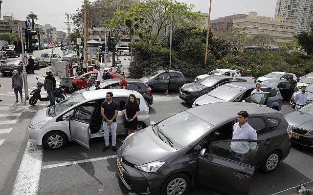 Israelis stand next to their cars as sirens mark a nationwide moment of silence in remembrance of the 6 million Jewish victims of the Holocaust, in Tel Aviv, Thursday, May 2, 2019. (AP Photo/Sebastian Scheiner via Jewish News)