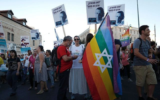 """Israelis participate in the Gay Pride Parade on July 30, 2015 in Jerusalem, Israel. The Hebrew signs read, """"Come out from the closet, the closet is death."""" (Lior Mizrahi/Getty Images)"""