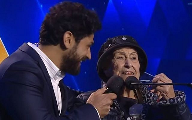 Illustrative. Host Aviv Alush, left, and torch-lighter Marie Nahmias, 93, at Israel's 71st Independence Day ceremony in Jerusalem, May 8, 2019. (Kan screen capture)