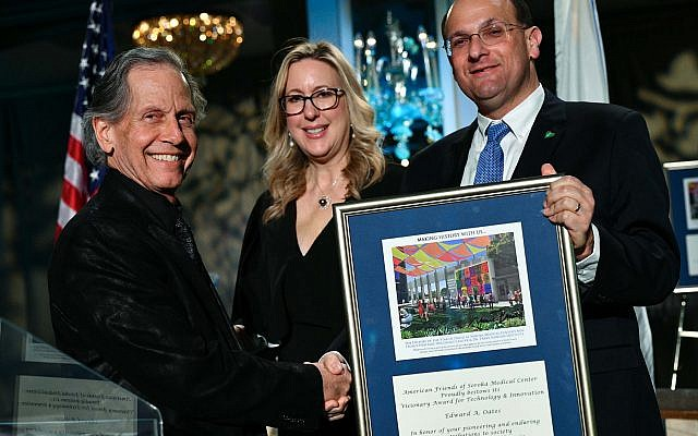 Rachel Heisler Sheinfeld and Dr. Shlomi Codish, right, present award to Edward Oates. Photo by Jared Siskin/Getty Images, courtesy of the American Friends of Soroka Medical Center