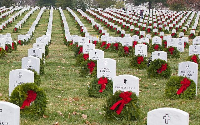 Volunteers with Wreaths Across America placed more than 100,000 remembrance wreaths on headstones of fallen soldiers of many religions, at Arlington National Cemetery, Virginia., December 13, 2013, including. (US Army photo by Spc. James K. McCann/Released, via Wikipedia)