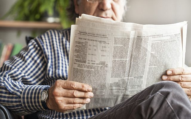 Illustrative. Man reading the newspaper. (iStock)