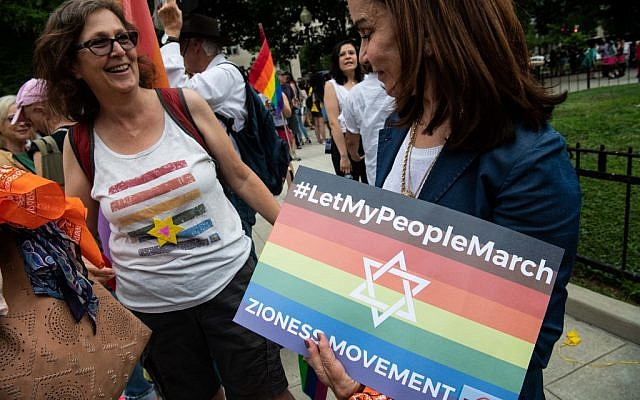 Lesbian activits take part in the Dyke March in Washington, DC, on June 7, 2019. (Photo by NICHOLAS KAMM / AFP)