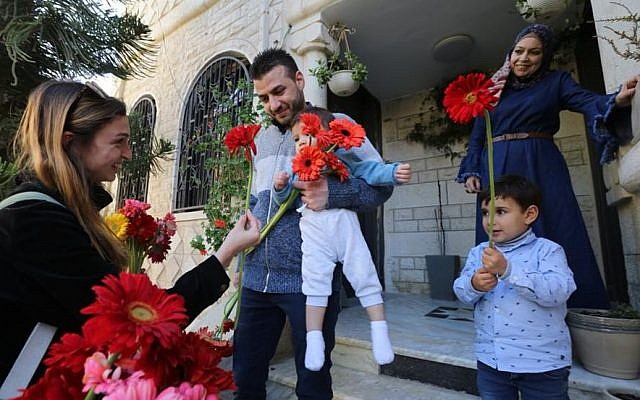 After Arab residents of  the French Hill neighborhood in Jerusalem had their cars vandalized, the Tag Meir Hebrew University chapter showed up in the neighborhood to hand out flowers to the Arab residents and then joined them in a solidarity protest. April, 2015 (Photo Credit: Yossi Zamir)