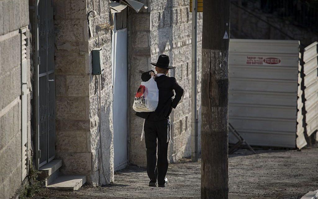 An ultra-Orthodox man seen walking in the Kiryat Yovel neighborhood in Jerusalem, on August 19, 2014. (Hadas Parush/Flash90)