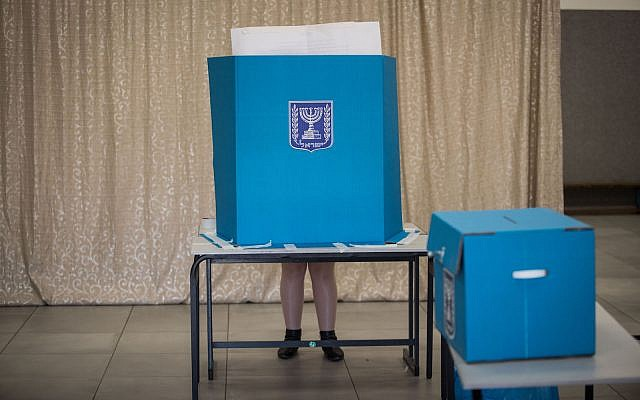 An Israeli citizen at a voting station in Jerusalem, during the Knesset Elections, on April 9, 2019. (Hadas Parush/Flash90)