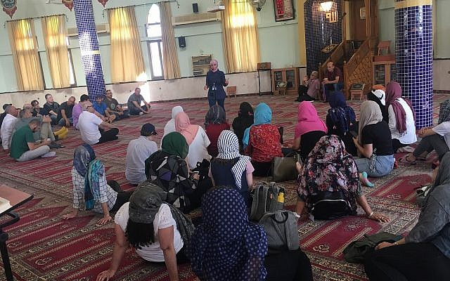 Staff members from Kan (the Israeli Public Broadcasting Corporation) learn about Islam in a Kafr Qara mosque as part of a tour organized by shared society NGO the Abraham Initiatives.