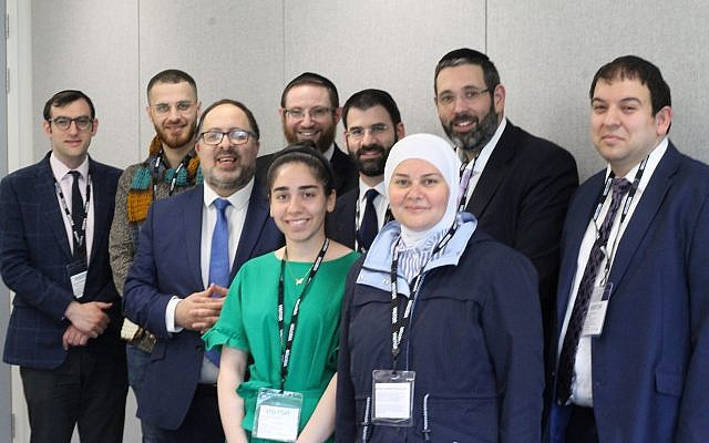 L to R - Rabbi Guttentag, Martin, Rabbi Mason, Rabbi Liss, Hafssa, Rabbi Birnbaum, Alyaa, Rabbi Levene, Rabbi Taylor. Only refugees' first names have been used.