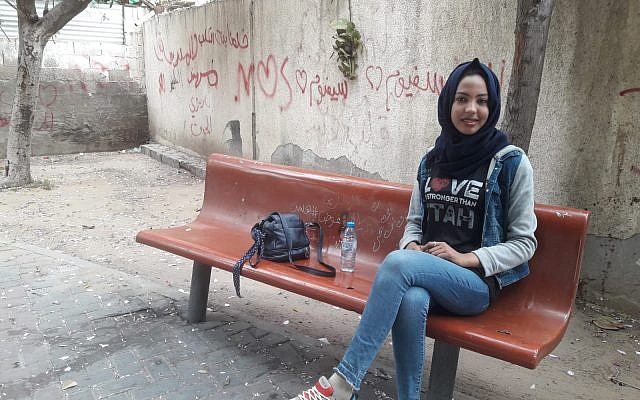 "Hedaya, 21, takes a breather while engaging in the ""Love is Stronger than Hate"" campaign on the streets of Gaza City. (Courtesy)"