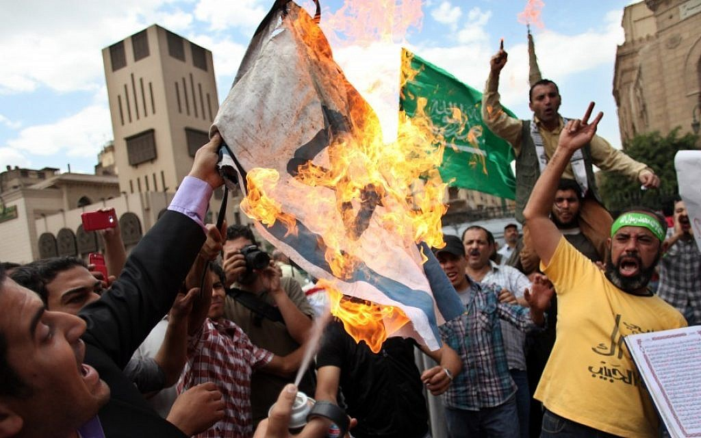 Egyptian men chant anti-Israeli slogans during a Muslim Brotherhood-staged anti-Israel rally in Cairo on May 11, 2013. (Khalil Hamra/AP)